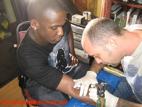 Malice Gets Re-Up Gang Tattoo.