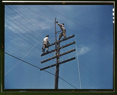 [Men working on telephone lines, probably near a TVA dam hydroelectric plant] (LOC).