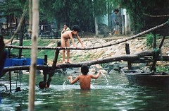 Vietnamese children (chris.bryant) Tags: people water swimming river children boats bamboo vietnam hoian bathing