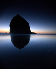 Haystack Rock (TroyMasonPhotography) Tags: sunset reflection beach nature oregon landscape pacificocean cannonbeach haystackrock deepblue 1on1 sigma1020 ishouldhavebeenbuildingafireformyfamilyonthebeach