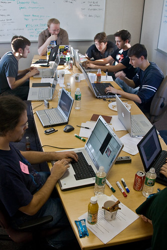geeks working around the table on their start-up