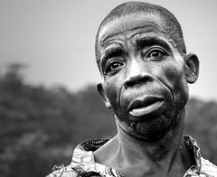 Faces of Congo (JakeBrewer) Tags: africa people blackandwhite bw men contrast portraits villages congo stories drc 2007 eastafrica interestingfaces democraticrepublicofcongo 100faves 10faves 25faves anawesomeshot aplusphoto megashot theperfectphotographer mwenga facesthattellastory myportfoliobest18 jakebrewerblog
