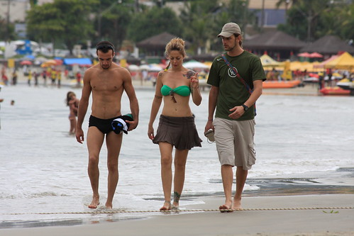 Tattooed girl and two boys walking at
