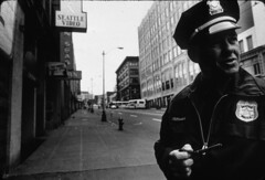 Policeman downtown, 1981 (Seattle Municipal Archives) Tags: seattle working uniforms badges 1980s policeofficers policemen downtownseattle seattlepolicedepartment seattlemunicipalarchives