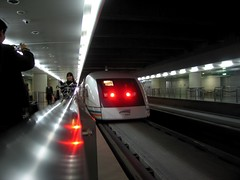 Shanghai Transrapid Maglev Train -   (meckleychina) Tags: china travel reflection face train geotagged asian vanishingpoint airport asia publictransportation shanghai chinese perspective rail transportation maglev   railing pudong shanghaiist smt highspeed transrapid zhongguo pvg highspeedrail longyang pudonginternational geo:country=china geo:city=shanghai geo:district=pudong pudongstation