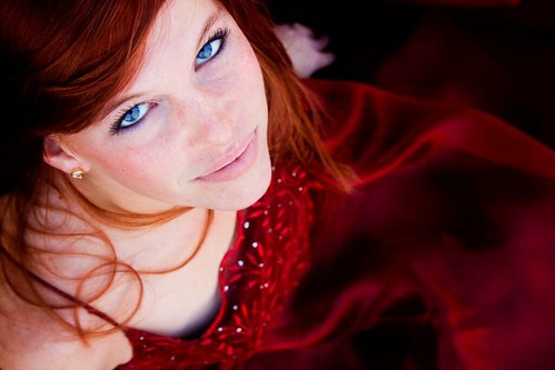 Gorgeous photo of a young lady in a red dress. The red dress and red hair