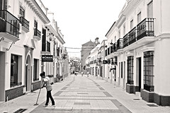 Morning in Moguer (gornabanja) Tags: street city travel houses vacation blackandwhite espaa holiday tourism sepia town blackwhite andaluca spain nikon d70 huelva pedestrian cleaning andalusia andalusien spanien sweeping moguer