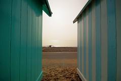 Felixtowe Beach huts (EddieMiller) Tags: wood blue sea sun white water concrete aqua paint glare shine stripe wave pebbles pop reflected flare hdr shimmer