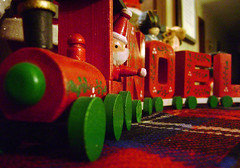 Noel Peace Train (Shawn Toohey) Tags: santa christmas new wood xmas decorations red england holiday color macro green art america train ma toy wooden peace painted massachusetts perspective wave noel claus mass plaid waving 2007 leominster