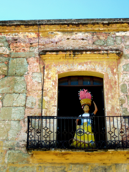 Paper Mache Woman on Balcony