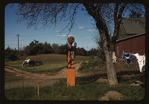 [Gas pump with clothesline, barn and horse-drawn wagon in background] (LOC)