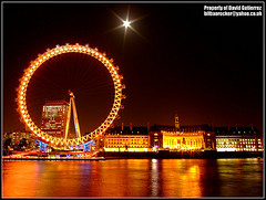 London Eye under the Moon Light at Night (david gutierrez [ www.davidgutierrez.co.uk ]) Tags: city uk travel light urban orange moon color reflection building london beautiful westminster thames architecture night buildings river dark spectacular photography photo interestingness amazing cityscape darkness image dusk centre cities cityscapes londoneye center structure architectural explore nighttime finepix londres architektur nights moonlight fujifilm sensational metropolis topf100 londra metropolitan impressive countyhall nightfall cityoflondon municipality edifice cites cityofwestminster 100faves s6500fd s6000fd fujifilmfinepixs6500fd londonmoonlight
