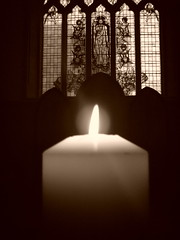 photo of a candle burning at st luke's church, holloway