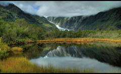 Franz Joseph glacier mirroring in a lake nearby - New Zealand (kryyslee) Tags: franz joseph glacier mirroring lake nearby hdr new zealand nouvelle zelande travel around world voyage autour du monde kryyslee christophe paquignon 2008 canon eos 400d backpacker adventure aventure photo trip photography amateur image images pict picture pictures photos pics round 50d foto christophepaquignon color couleur colors couleurs