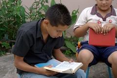 Jordi studies the catechism