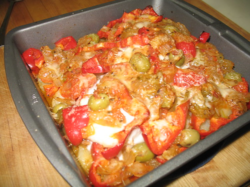 Baked Halibut over potatoes, olives, red peppers, and marinara