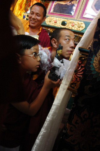 Offering a Ku, or Buddha statue to his grandfather, a young Sakya lama, Lamdre (Path and Fruit), Tharlam Monastery of Tibetan Buddhism, Boudha, Kathmandu, Nepal 2118