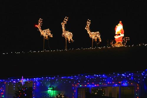 Santa and reindeer roof decoration owingslawrenceville com