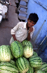 Watermelon seller  Bundi (Julien Mailler) Tags: world street travel boy portrait people india kids children asian julien kid asia child indian young watermelon asie rajasthan inde bundi reflectionsoflife lovelyphotos jules1405 unseenasia mailler asiatiquestravel