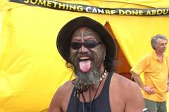 Face (chris_can_do) Tags: newzealand portrait face hat tongue tattoo shades nz maori 2008 waitangi aotearoa facial moko whakapapa stickout waitangiday facialtattoo waitangifestival