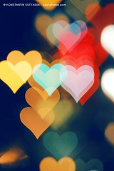 Hearts bokeh (Konstantin Sutyagin) Tags: light red holiday abstract blur color love yellow vertical night dark hearts photo colorful heart bokeh many background illumination blurred highlights valentine nightlife shape heartshaped defocused