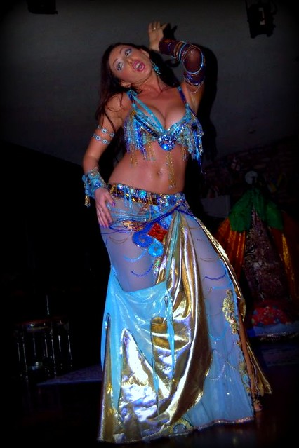 Belly dancer in blue performs at Istanbul dinner club