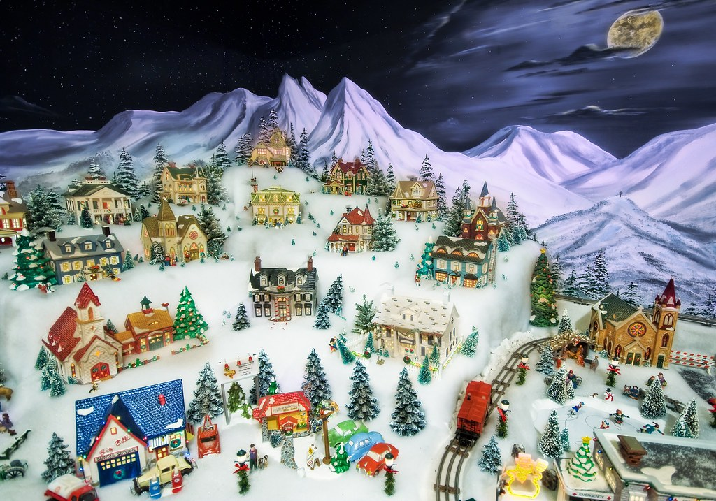 The Snowy Village in the Moonlight