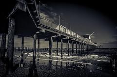 Southwold pier split-toned 35mm (Mister Electron) Tags: 35mm 35mmfilm kodakektachromeelite100 pier plustek8200ai southwold diapositive filmcamera pillars rust slide transparency 100asa 35mmslr kodak kodakelitechrome plustek slr analogue film iron posts silverhalide stilts outdoors sea northsea suffolk