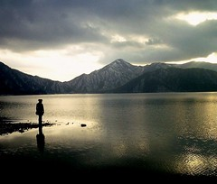 Solitude (gaijin in nihon (UmKenza)) Tags: lake mountains marie japan clouds lights solitude mood alone loneliness shadows unique dream lac silence nikko nuages facetoface solitary mighty reflexion magicmoments solitaire montagnes  grandeur seuleaumonde 10faves instantfave challengeyouwinner betterthangood theperfectphotographer humanandthenature grandeurdivine grandnessandmagnificence avision souvenirdupasse panasonicsnapshotcamera