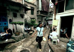 . (GraemeNicol) Tags: life guangzhou china street old news walking reading alley outdoor district candid newspapers scene lane information