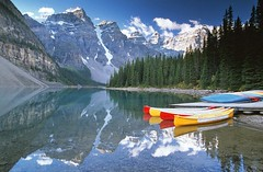 Moraine Lake Canoes (JLMphoto) Tags: lake canada canoes banff reflexions moraine themoulinrouge supershot magicdonkey flickrsbest specland abigfave platinumphoto anawesomeshot megashot thegardenofzen thegoldendreams goldstaraward absolutelystunningscapes jlmphoto boatislandpoetry