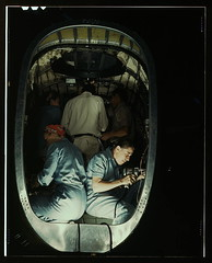 Working inside fuselage of a Liberator Bomber, Consolidated Aircraft Corp., Fort Worth, Texas  (LOC) (The Library of Congress) Tags: work airplane workers women october war texas rosietheriveter labor military wwii worldwarii ww2 libraryofcongress 1942 bomber liberator 1941 fortworth b24 worldwar2 wartime riveter manufacturing fortworthtx consolidatedaircraft xmlns:dc=httppurlorgdcelements11 riveters liberatorbomber october1942 dc:identifier=httphdllocgovlocpnpfsac1a34928 consolidatedaircraftcorporation rivetgun howardhollem howardrhollem