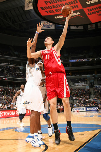 Yao Ming shoots over Antawn Jamison on Tuesday night in a 92-84 win over the Washington Wizards.  Yao scored 21 points and Luther Head added 24 to help the Rockets win their third straight game.