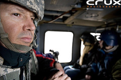 Looking over Baghdad (cruxphotography.com) Tags: camera chris man dan closeup soldier photography fly chopper war iraq helmet helicopter baghdad journalism heli crux rojas marinelli cruxphotography4444 rojas1983