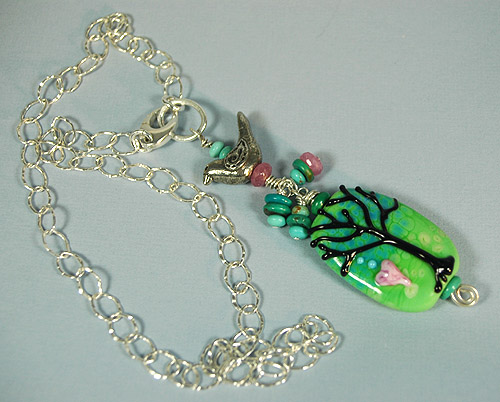 folk art bird and tree necklace