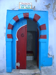 Door of the Hammam (olga_rashida) Tags: hammamet tunisia tunesien madina oldcity altstadt tunisie medina vieilleville hammam porte bleu blue red rouge turkishbath bainturc bainmaure bain bath goldstaraward vivid abigfave betterthangood goldenglobe colorphotoaward kuwaitartphoto colourartaward aplusphoto diamondclassphotographer decayed platinumheartaward door tr excapture  trkischesbad bad mywinners