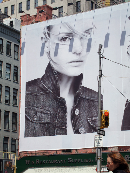 big face on billboard, Houston Street, Manhattan, NYC