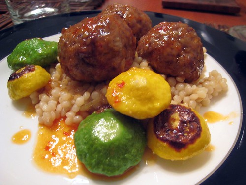 Italian-style meatballs with pattypan and sunburst squash, israeli couscous, and Dario's glaze