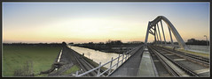 "5314'35.00""N   633'23.45""O (Wesley Danes) Tags: bridge panorama sun netherlands train sunrise movement stitch nederland rails wesley brug groningen zon hdr trein danes spoorbrug d80"