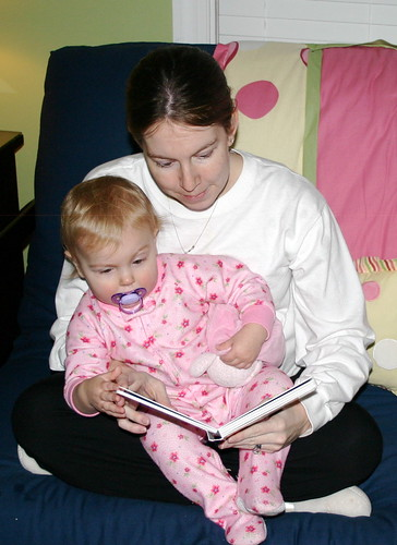 Heather reading to Anna before bed