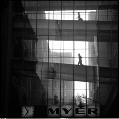 in time (memetic) Tags: city urban bw 120 6x6 silhouette mediumformat shopping blackwhite day tl overpass melbourne d76 hp5 figures ilford myer p6 pentaconsix sonnar 180mm