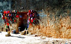 Zanzibar Rasta Hats. (avp17) Tags: africa door travel hat sign stone d50 tanzania concrete 50mm town store nikon sale daressalaam unesco doorway zanzibar stonetown nikkor 18 50 rasta rastafarian