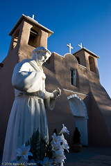 St Francis de Asis adobe church (BACHarbin) Tags: sculpture usa brown white newmexico art saint architecture still catholic quiet personal prayer churches statues crosses photoblog adobe nm romancatholic franciscan stfrancisofassisi ranchosdetaos belltowers religioussymbols sanfranciscodeasischurch submittedtophotoshelter