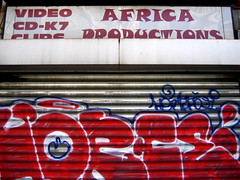 Africa Productions (Gabri Le Cabri) Tags: blue red white streetart paris metal shop silver graffiti shutters 75018 horf paris18 horph africaproductions