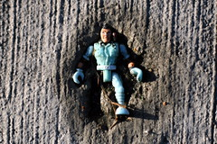 Embedded (MacGBeing) Tags: dublin buzz geotagged toy concrete soldier 50mm trapped doll pavement cement sidewalk figurine wicklow kerb bray toysoldier 30d embedded legless canon30d f18ii discardedtoys lowerdargleroad enemylines rakedconcrete