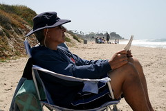 Rudy reading on the beach at San Clemente