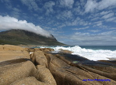 the rocks, the sea and ... (Jan-Krux Photography) Tags: blue sea sky seascape mountains landscape southafrica town rocks beaches cape e510 zd supershot 714mm abigfave diamondclassphotographer