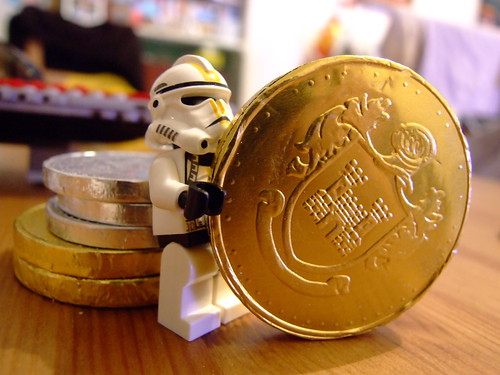 Storm trooper, holding a big gold coin