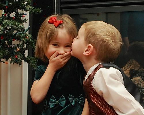 Boy kissing Blushing Girl