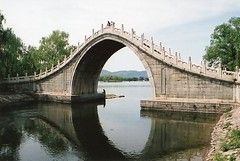 Arched Bridge at the Summer Palace, Beijing (chris.bryant) Tags: china bridge trees summer sculpture lake water stone reflections concrete asia day arch afternoon picturesthroughholes beijing summerpalace picturesque height wmp 5photosaday stonebridges goldstaraward worldtrekker 5halloffame vanagram oltusfotos artofimages
